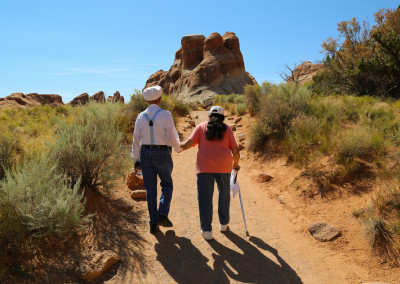 Elderly Japanese Tourists Explore Arches